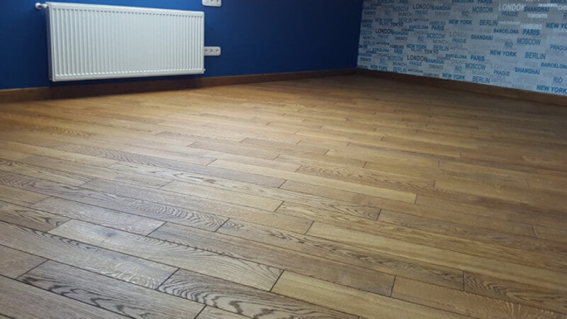 An apartment with hardwax oil finished hardwood flooring running at a 45 degree.