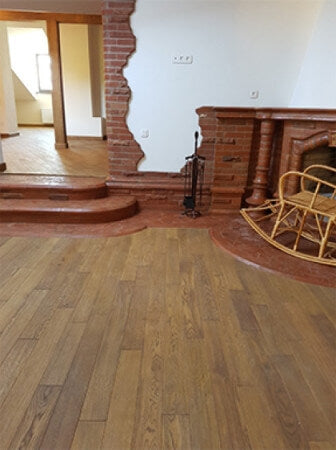 Brick and wood flooring and stairs.