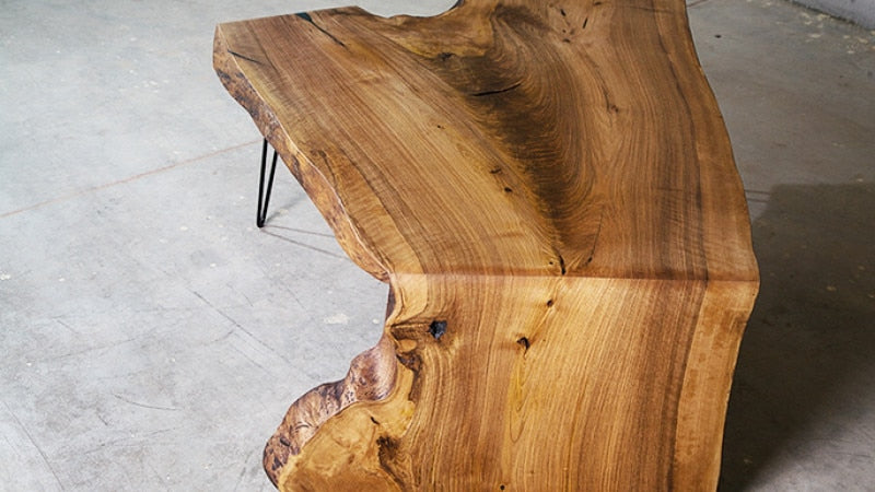 Live edge waterfall table finished with Rubio Monocoat's Oil Plus 2C in the color Pure.