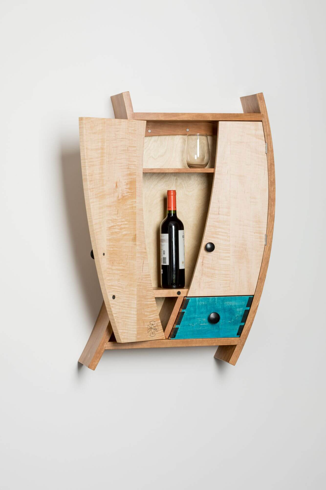 Unique wooden liquor cabinet finished with Rubio Monocoat.
