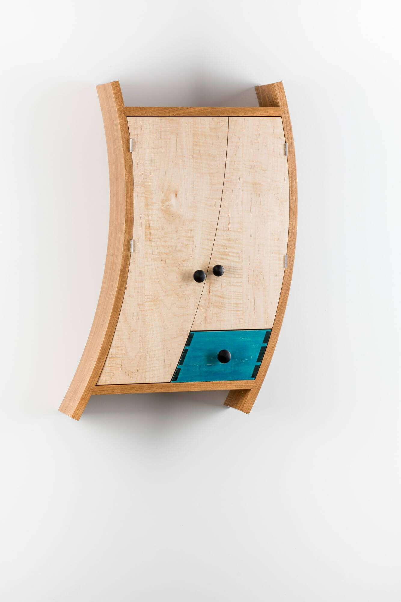 Wooden liquor cabinet made from multiple wood species is finished with Rubio Monocoat.