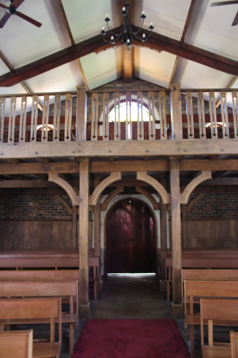 Renovating wood pews and balcony in a church.