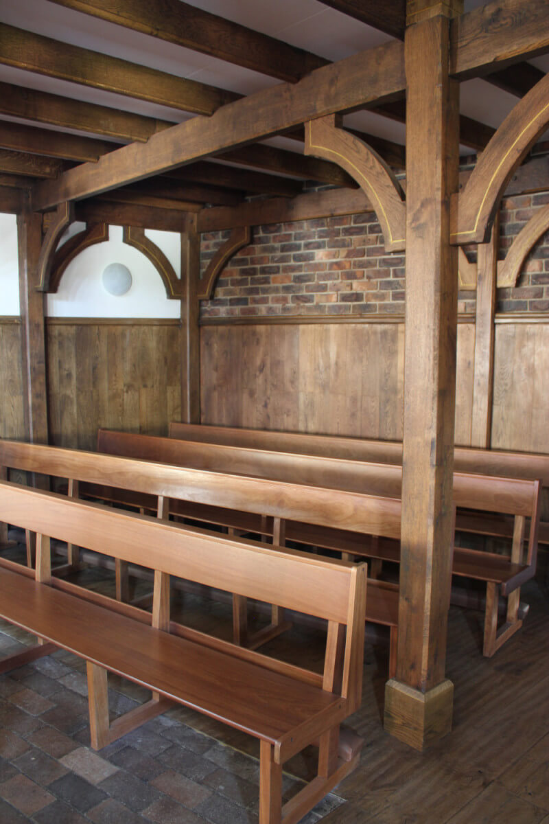 Wooden architectural details and pews in a church.