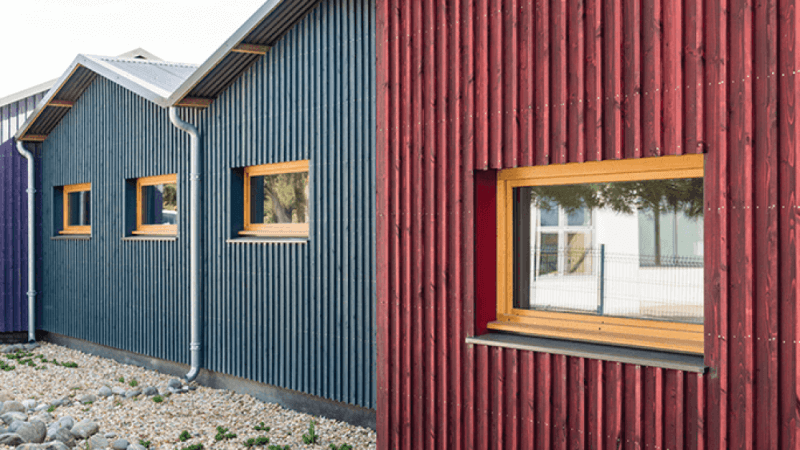 Colorful wooden buildings using an exterior paint alternative.
