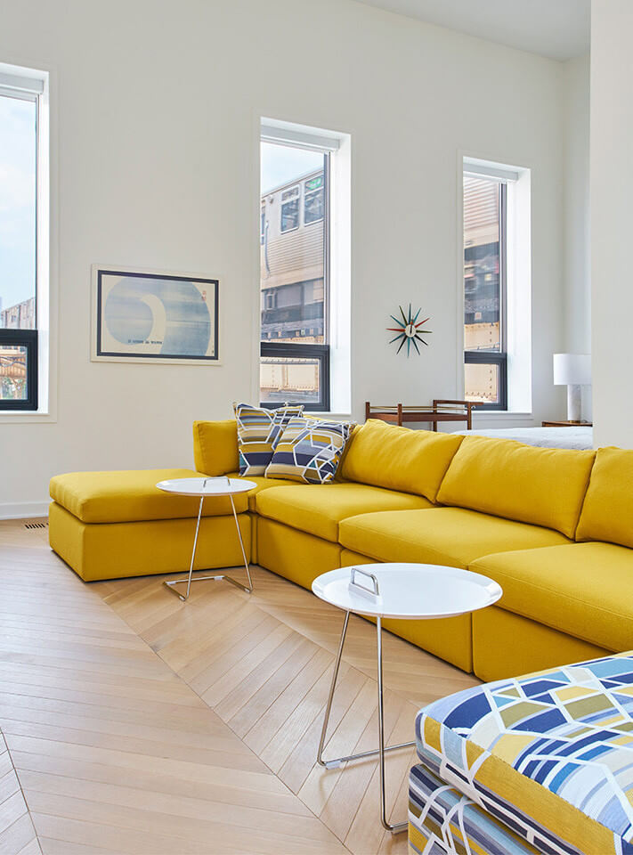 Colorful furniture contrasts with light hardwood floors finished with Rubio Monocoat Oil Plus 2C.