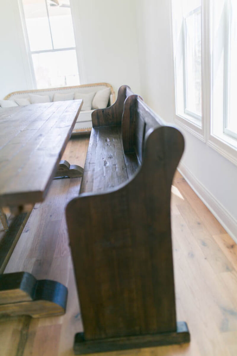 Vintage table in dining room featuring reclaimed oak flooring finished with Rubio Monocoat.