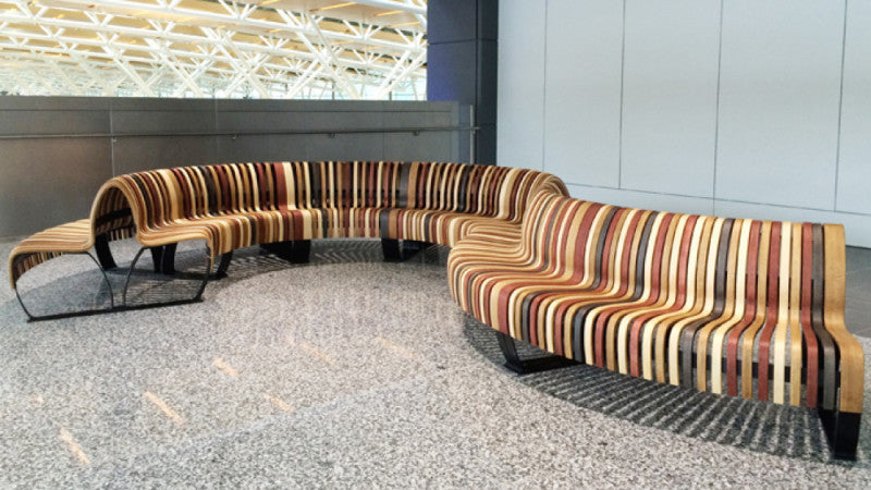 Unique wooden bench in Calgary International Airport finished with Rubio Monocoat hardwax oil.