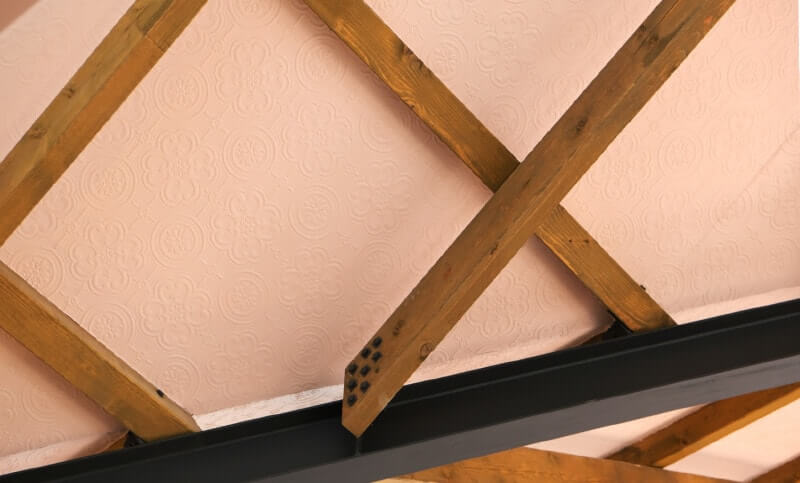 Crossing ceiling joists.
