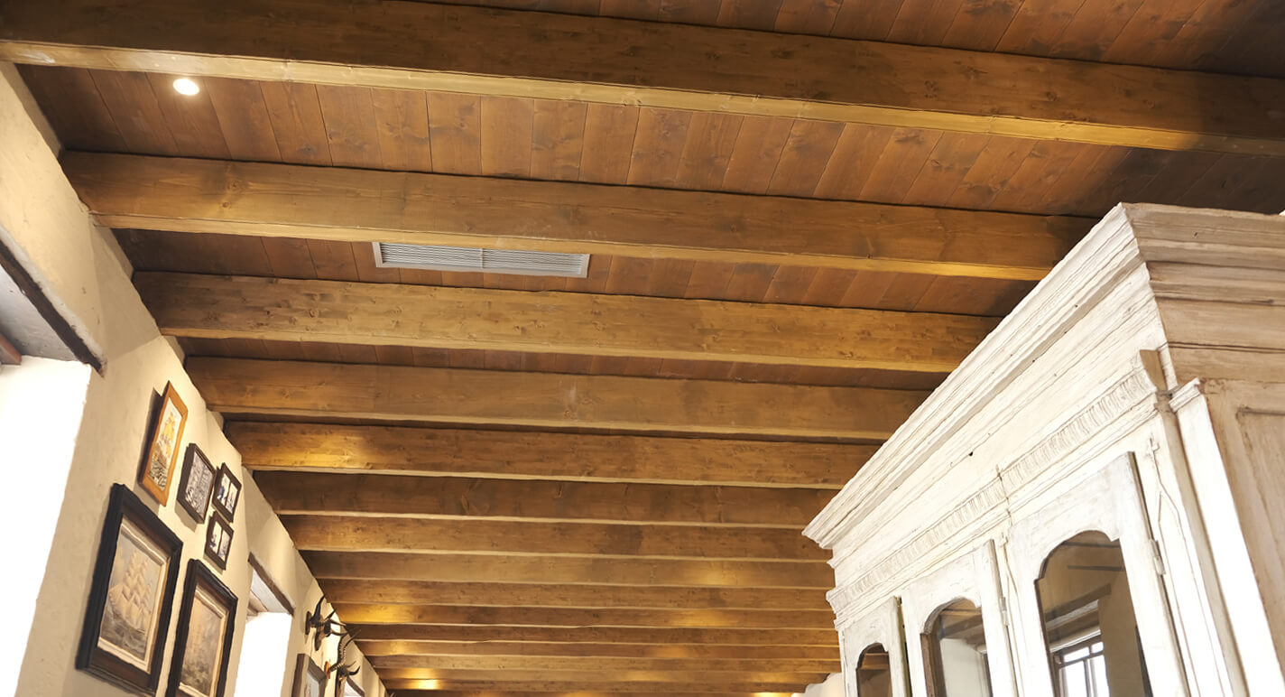 Ceiling beams finished with hardwax oil wood finish.