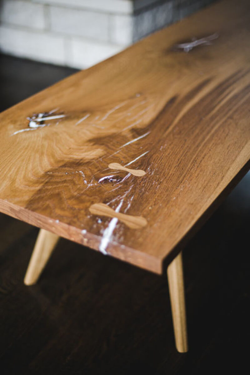 Solid white oak coffee table with a matte wood finish, white epoxy, and bowties.