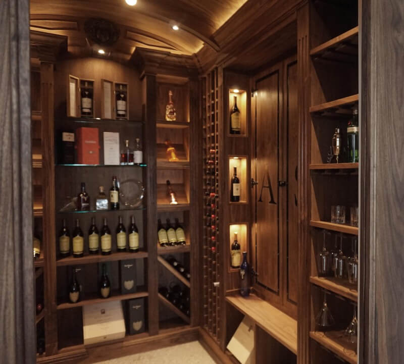 Large walk in liquor cabinet made from walnut wood.