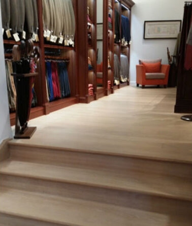 Stairs in a clothing store with Rubio Monocoat Oil Plus 2C in the color natural on them.