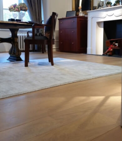 An oak floor with a natural wood finish.