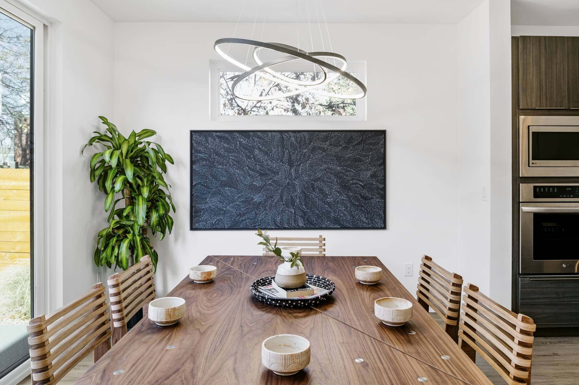 Beautiful walnut dining table staged in a modern dining room.