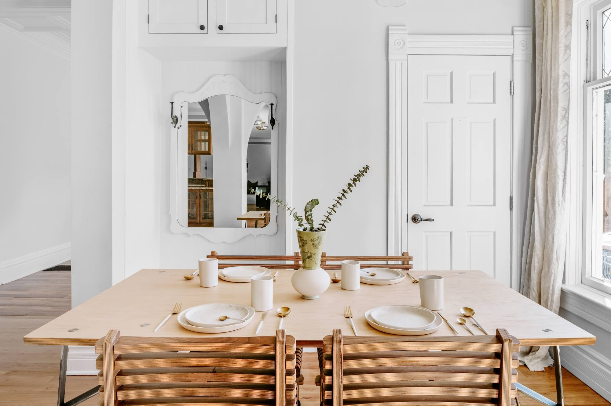 Birch wood dining table in a light room.