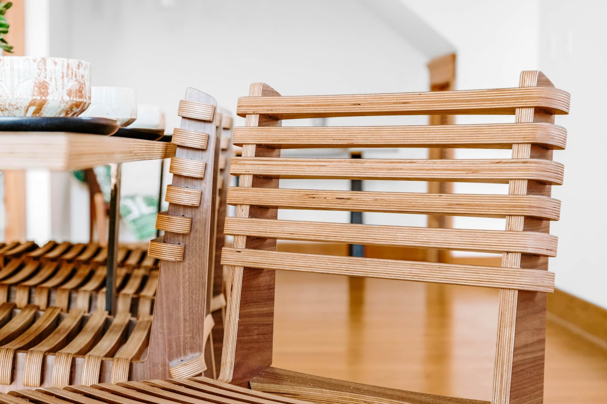 Responsibly sourced wood chairs with environmentally friendly wood finish on them.