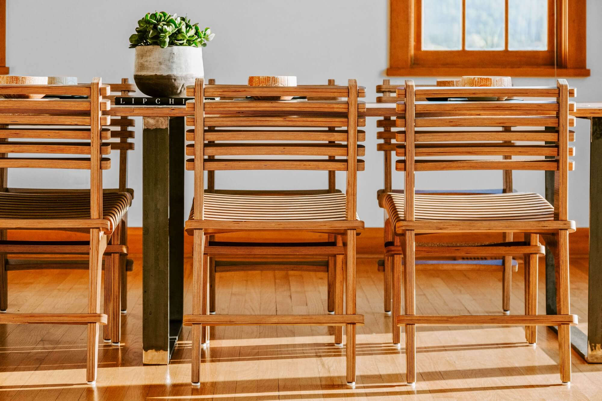 Dining table chairs made from responsibly sourced wood materials.