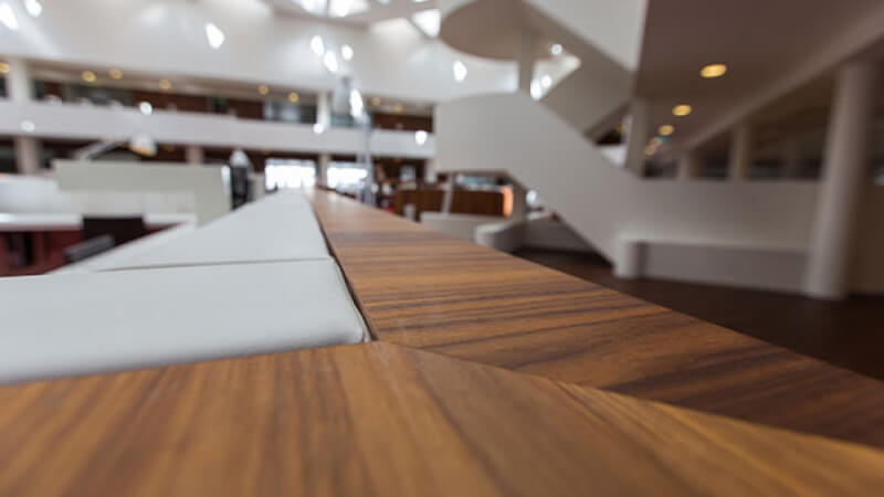 Details of the Walnut accent in a university study hall finished with hardwax oil.