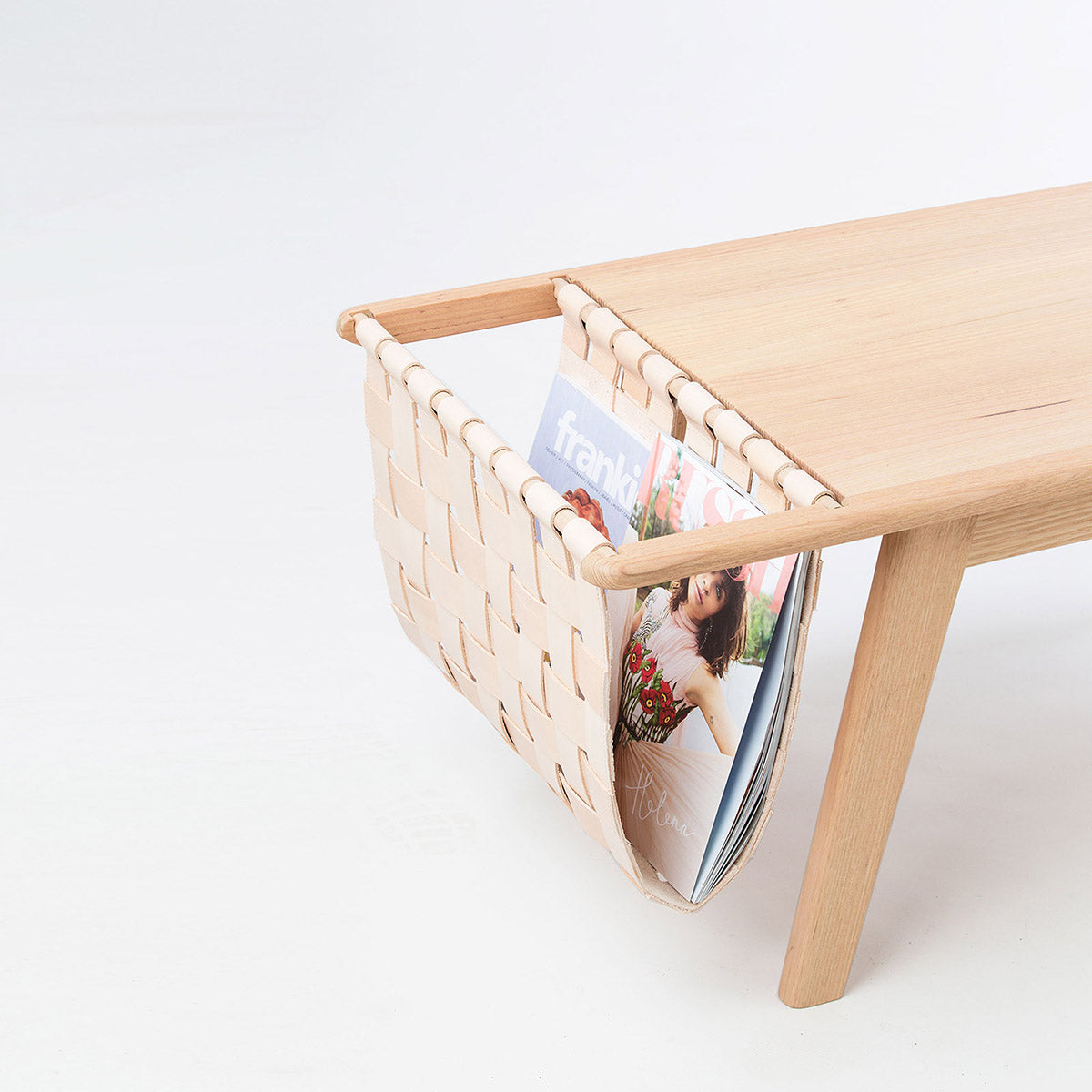 Coffee table with built in magazine holder.