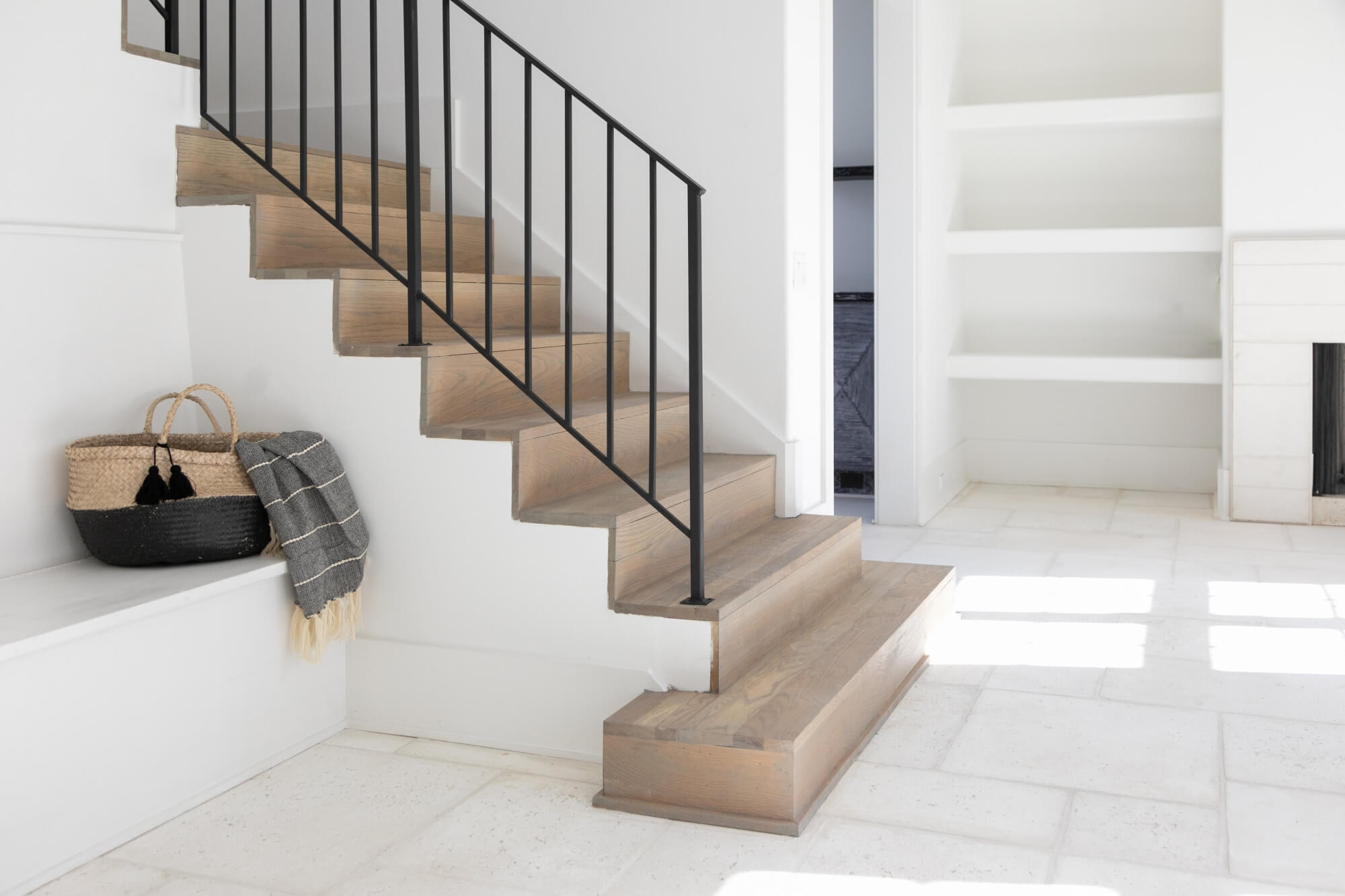 White oak stair treads in a light white living area.
