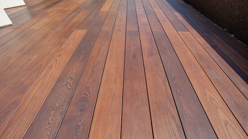 A wood deck finished with eco-friendly hardwax oil wood finish.