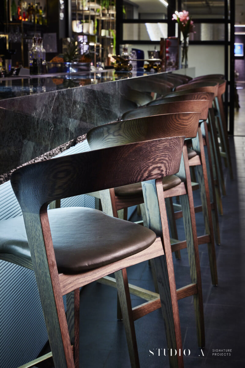 Wooden chairs at bar finished with Rubio Monocoat.
