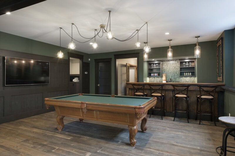 Billiards room with wood flooring finished with Rubio Monocoat.