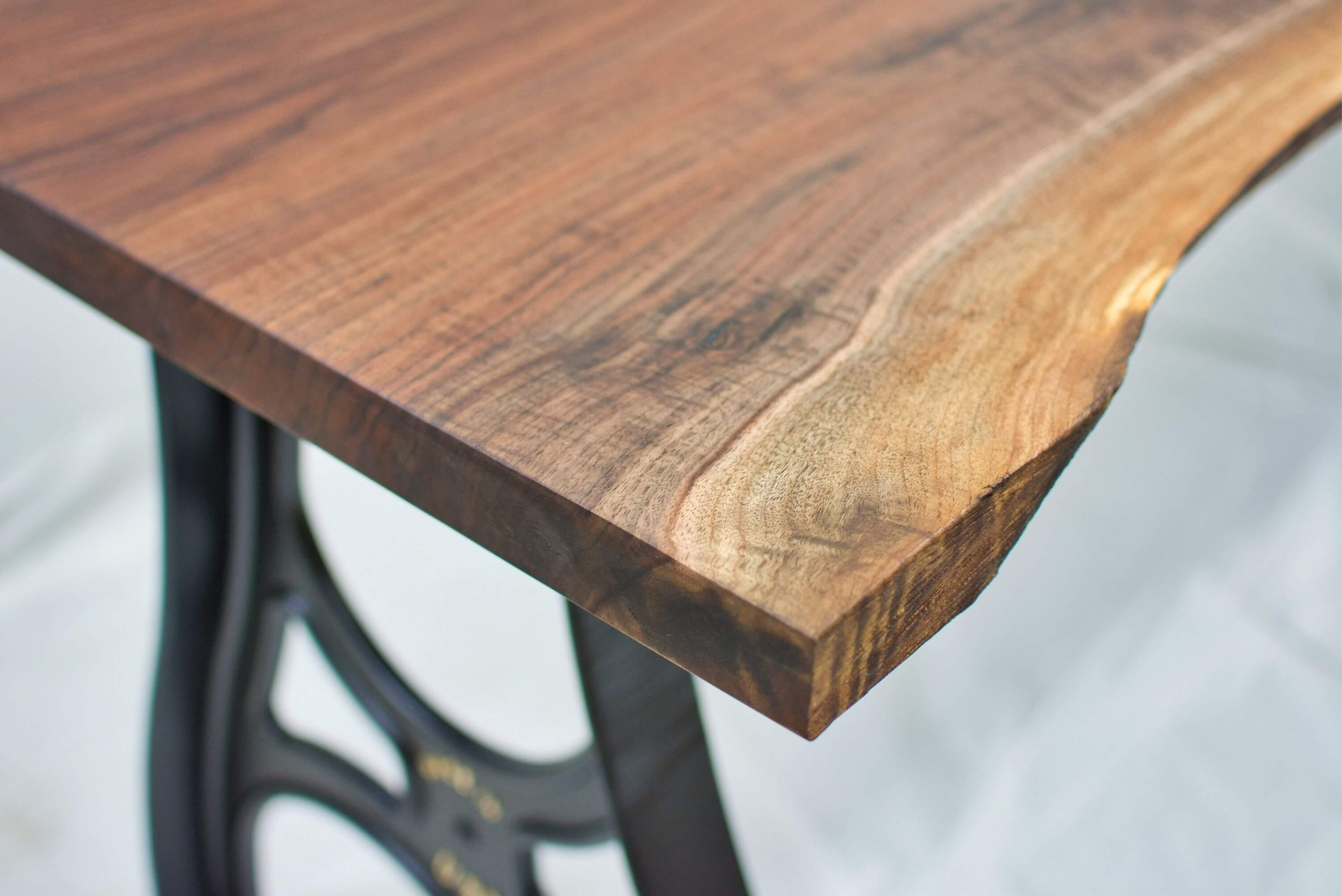Walnut table with cast aluminum legs finished with Rubio Monocoat Oil Plus 2C.