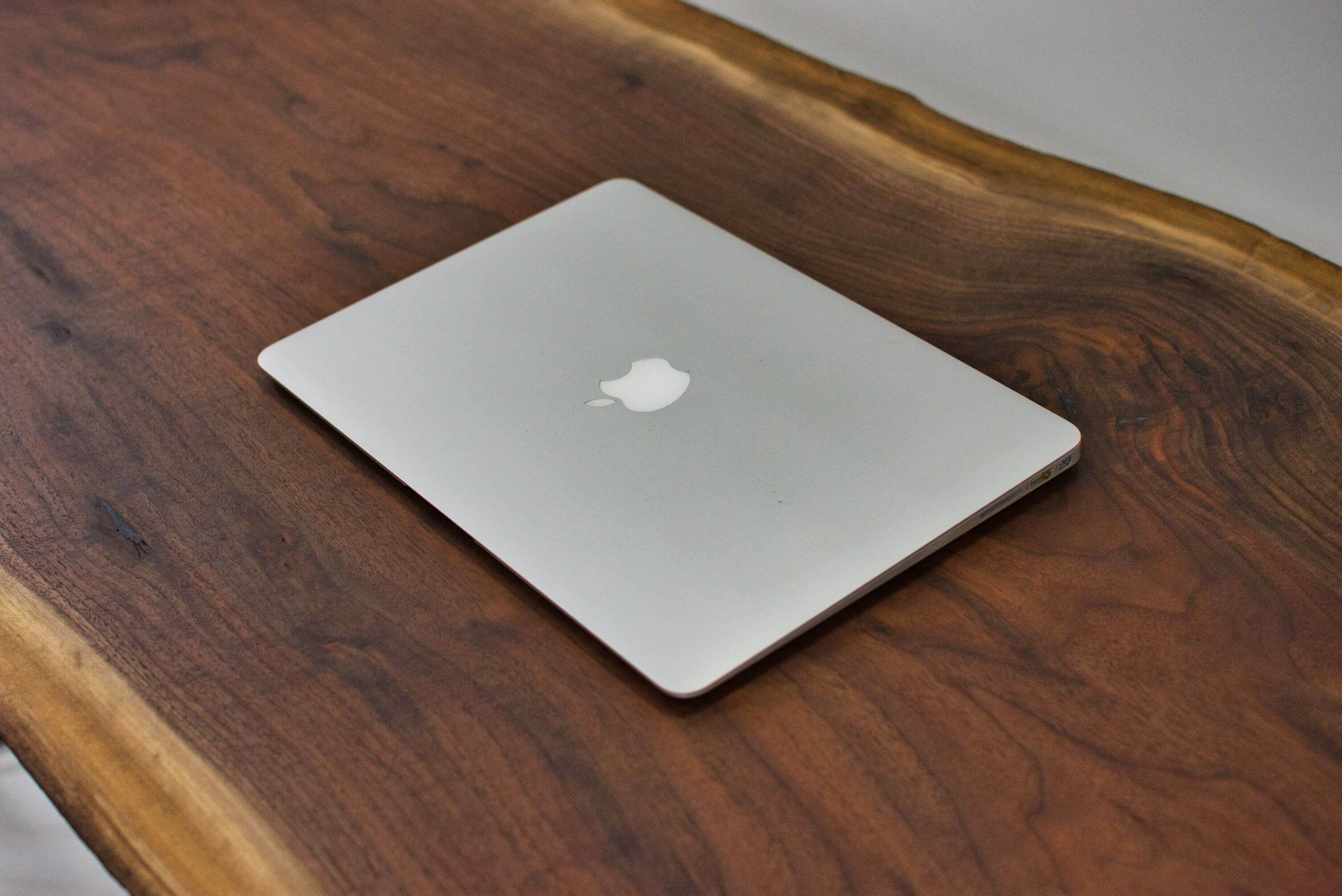 Apple computer on a beautiful walnut desk finished with Rubio Monocoat Oil Plus 2C.