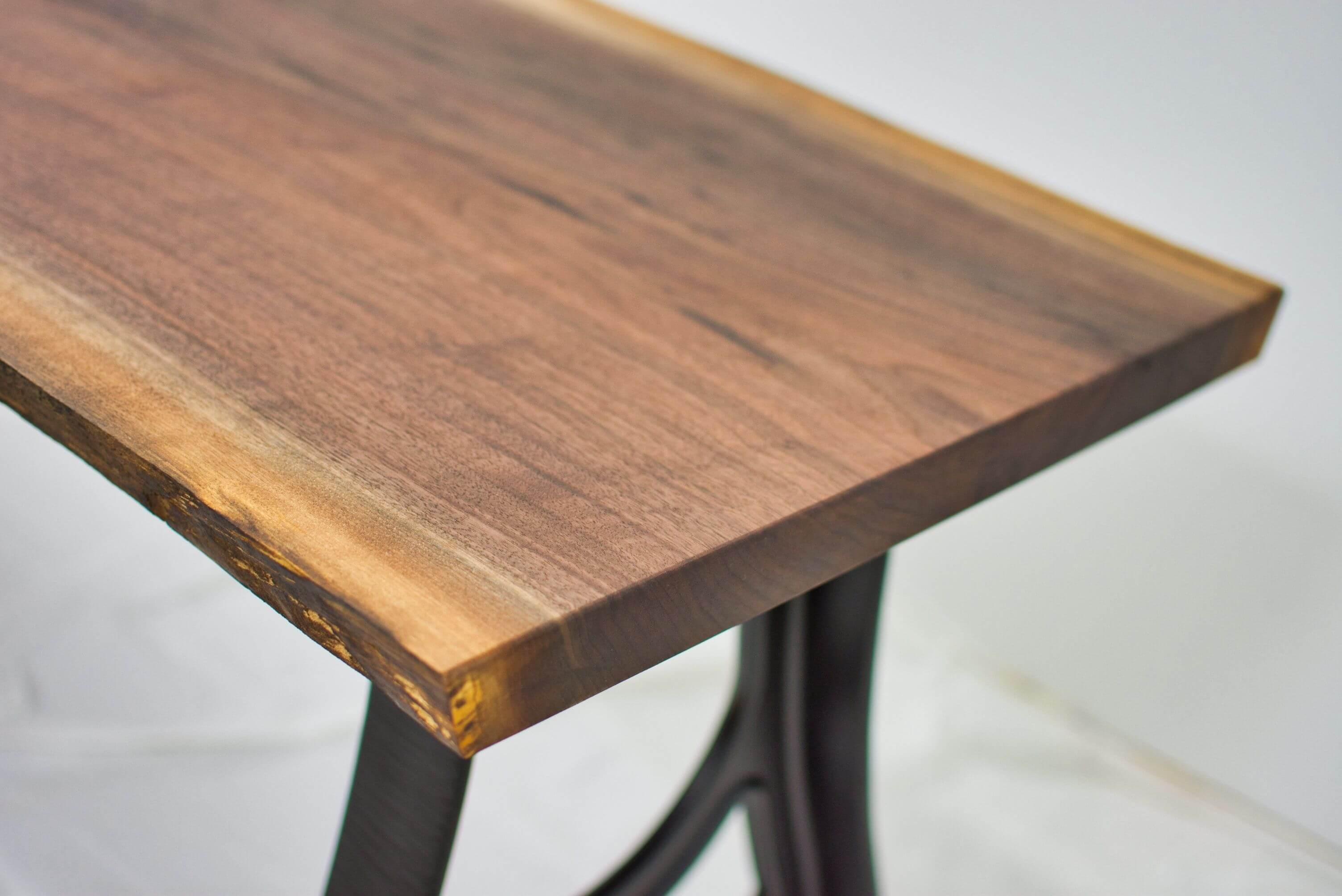 Beautiful live edge on this walnut desk finished with a hardwax oil from Rubio Monocoat.