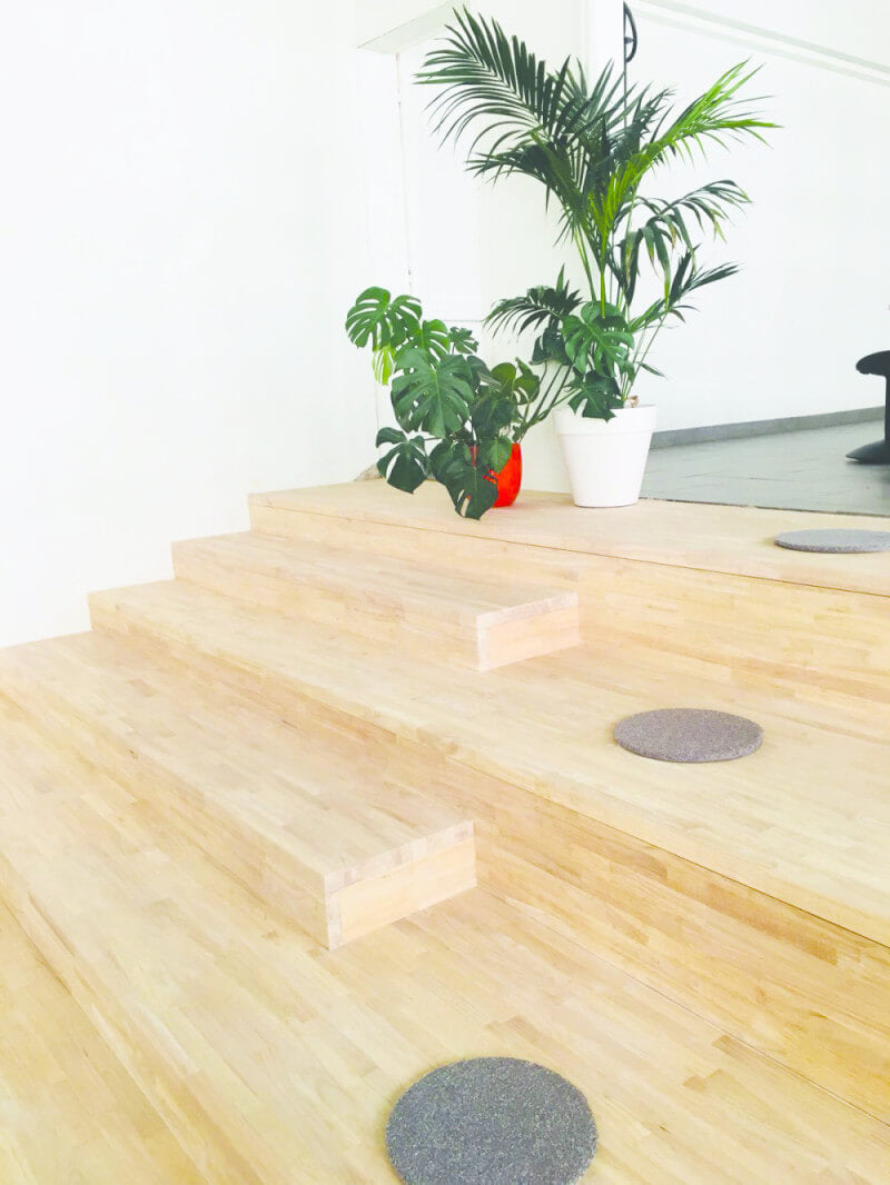 Wood steps in a classroom for sitting on.