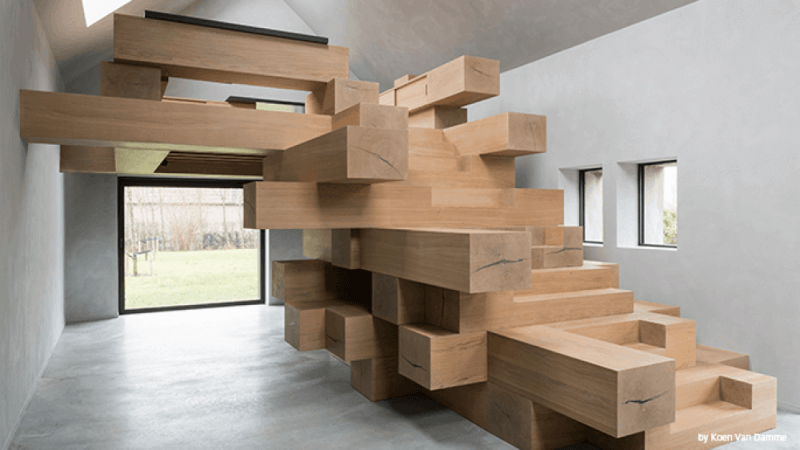 Life-like Jenga design from architect inside of office leading up to the upper office area.