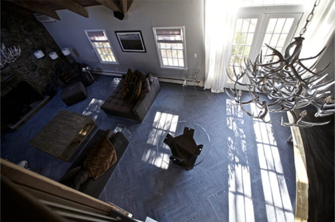Top-down view of a living area with herringbone wood floors that are fumed and finished with white oil.