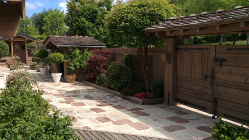 A fence and gate that were renovated and restored using Rubio Monocoat hardwax oil wood finish.