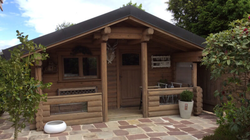 The front of a small wood cabin chalet.