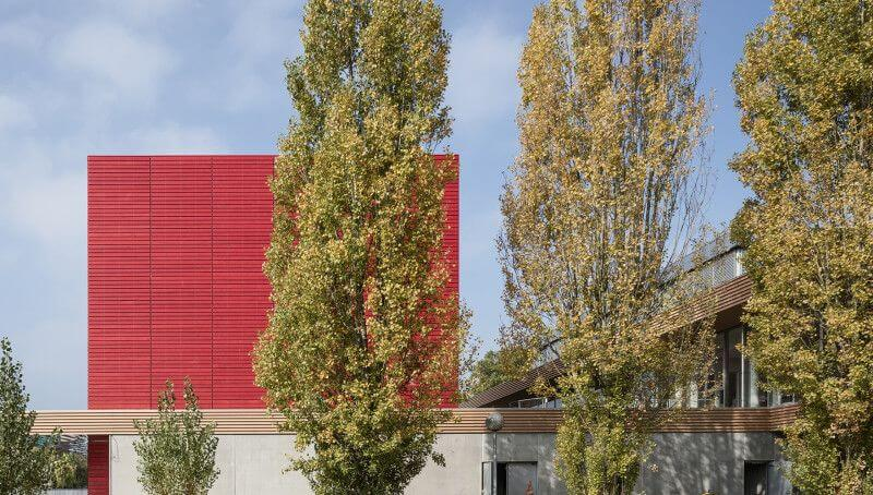 Vibrant color from Rubio Monocoat used to finished exterior wood on library.