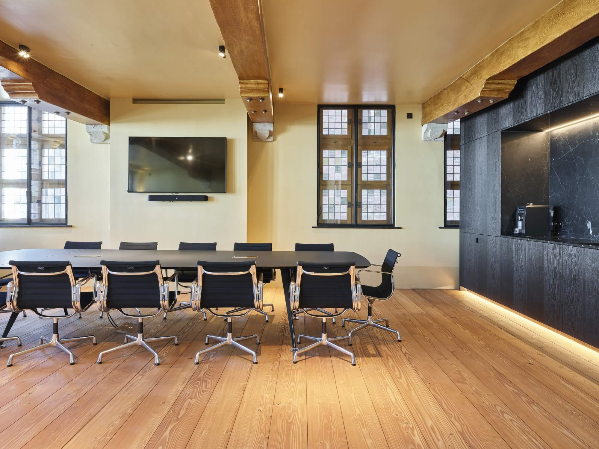 Matte wood floors in an office conference room.