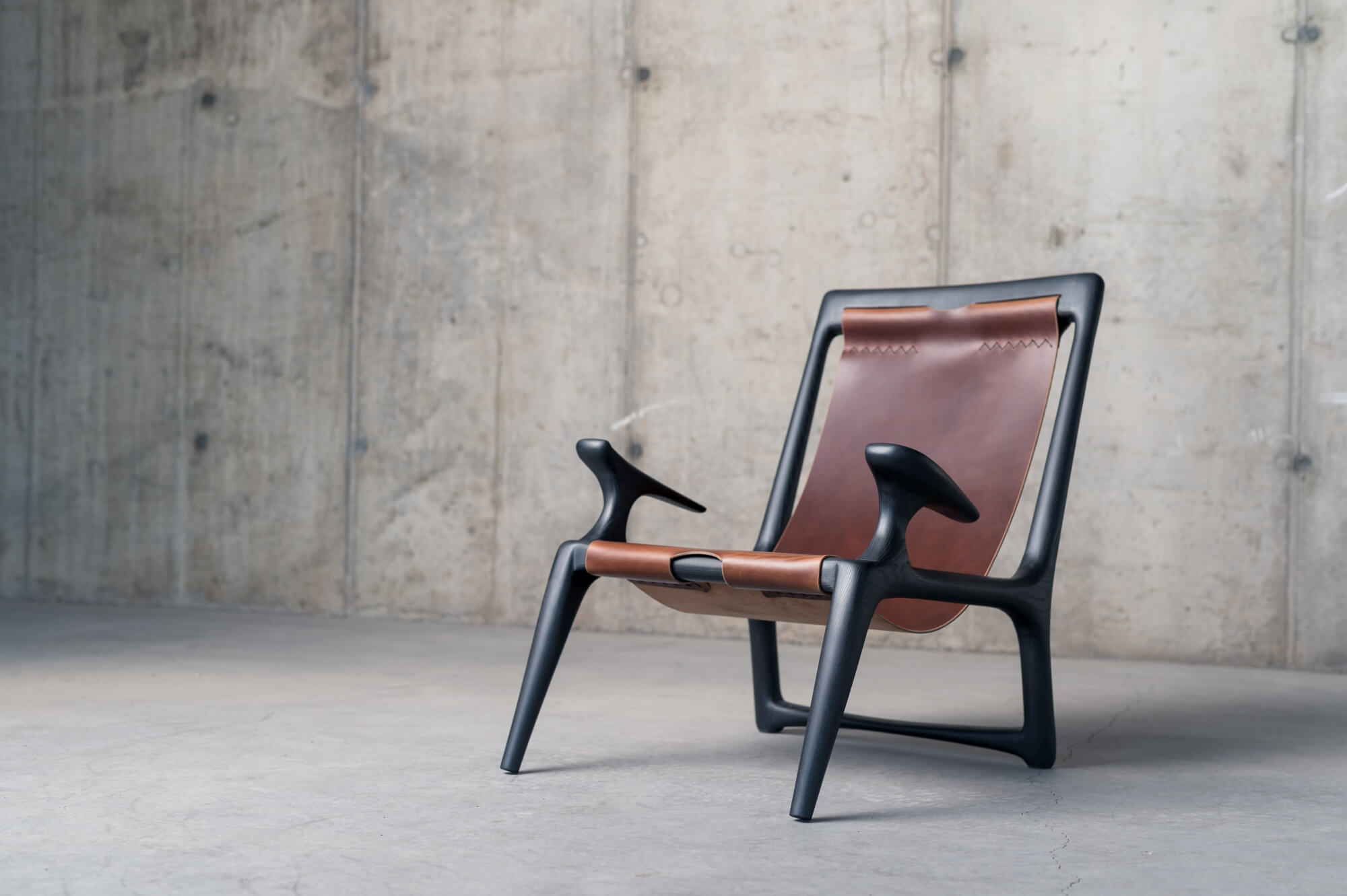 Custom chair made out of leather and wood.