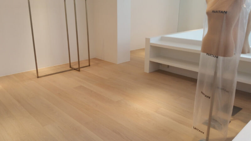 Clothing boutique in Brussels features oak wood flooring finished with Rubio Monocoat.