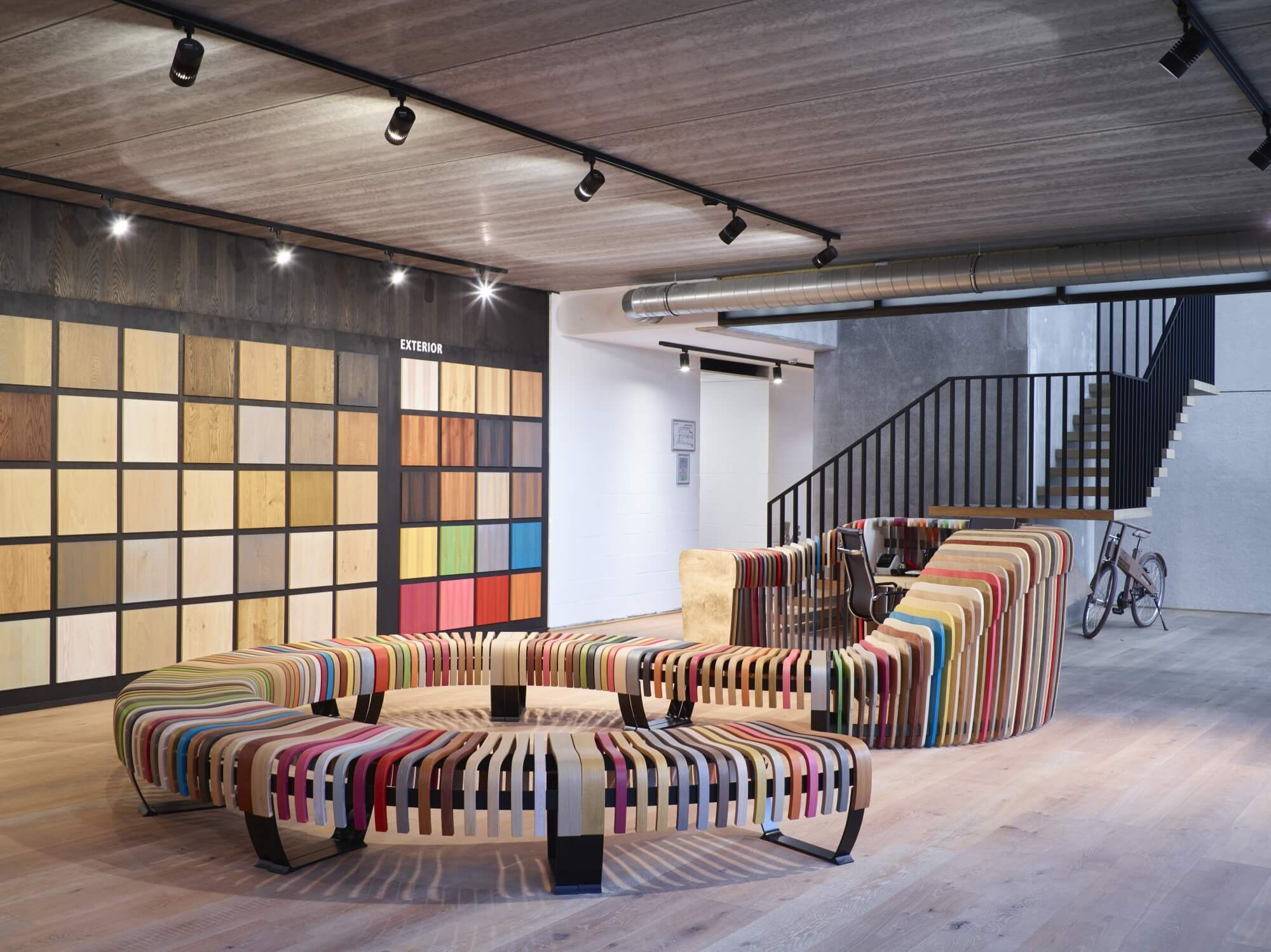 Rubio Monocoat colorful wood bench at headquarters in Belgium.