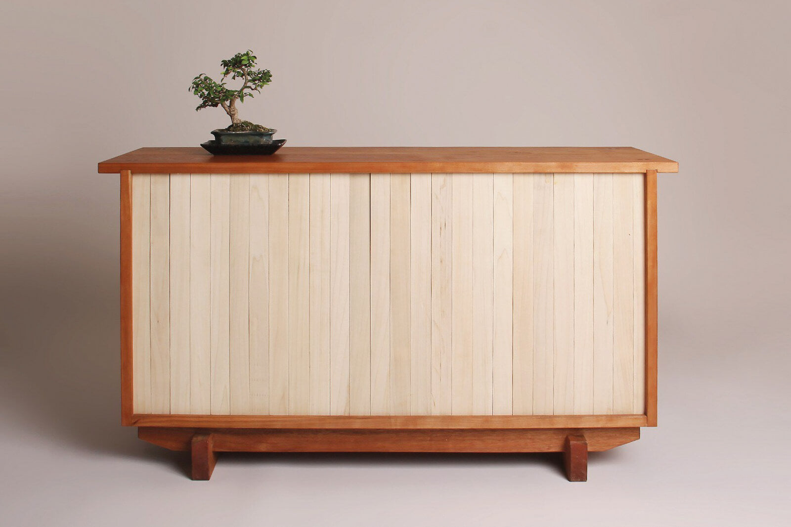 Poplar and cherry wood cabinet.