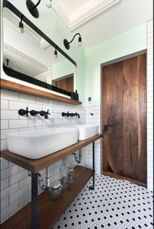 Bathroom remodel using salvaged black walnut accent pieces.