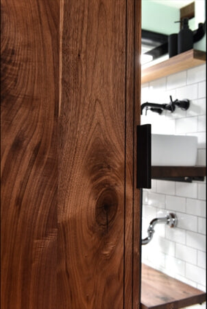 Detail shot of a salvaged black walnut barn door finished using Rubio Monocoat Oil Plus 2C