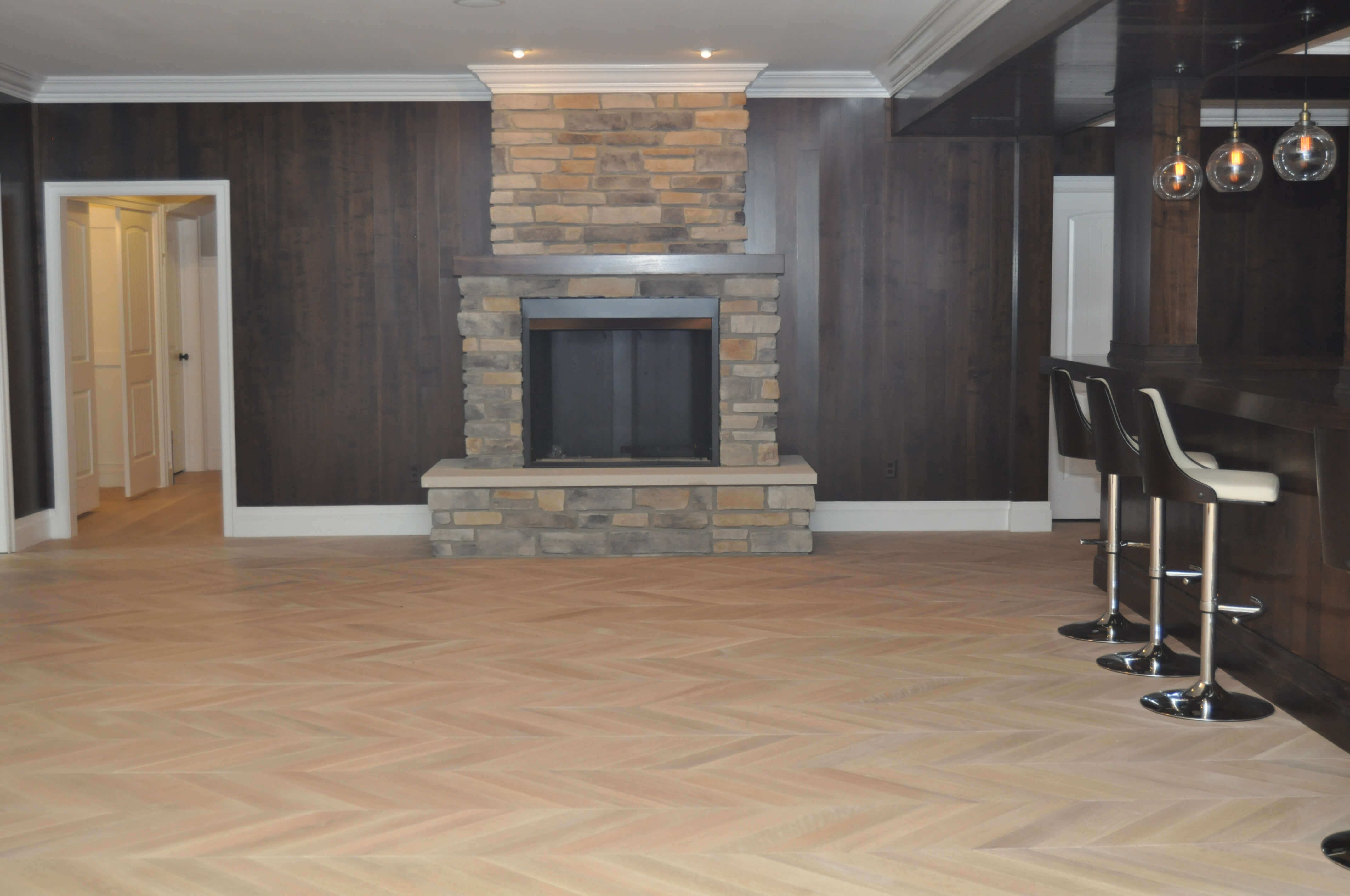 Wide view of white oak chevron floor finished with Rubio Monocoat.