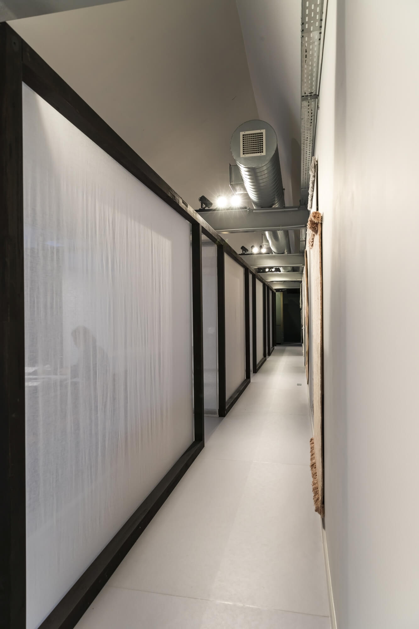 Long hallway in new office design with dark wood borders.
