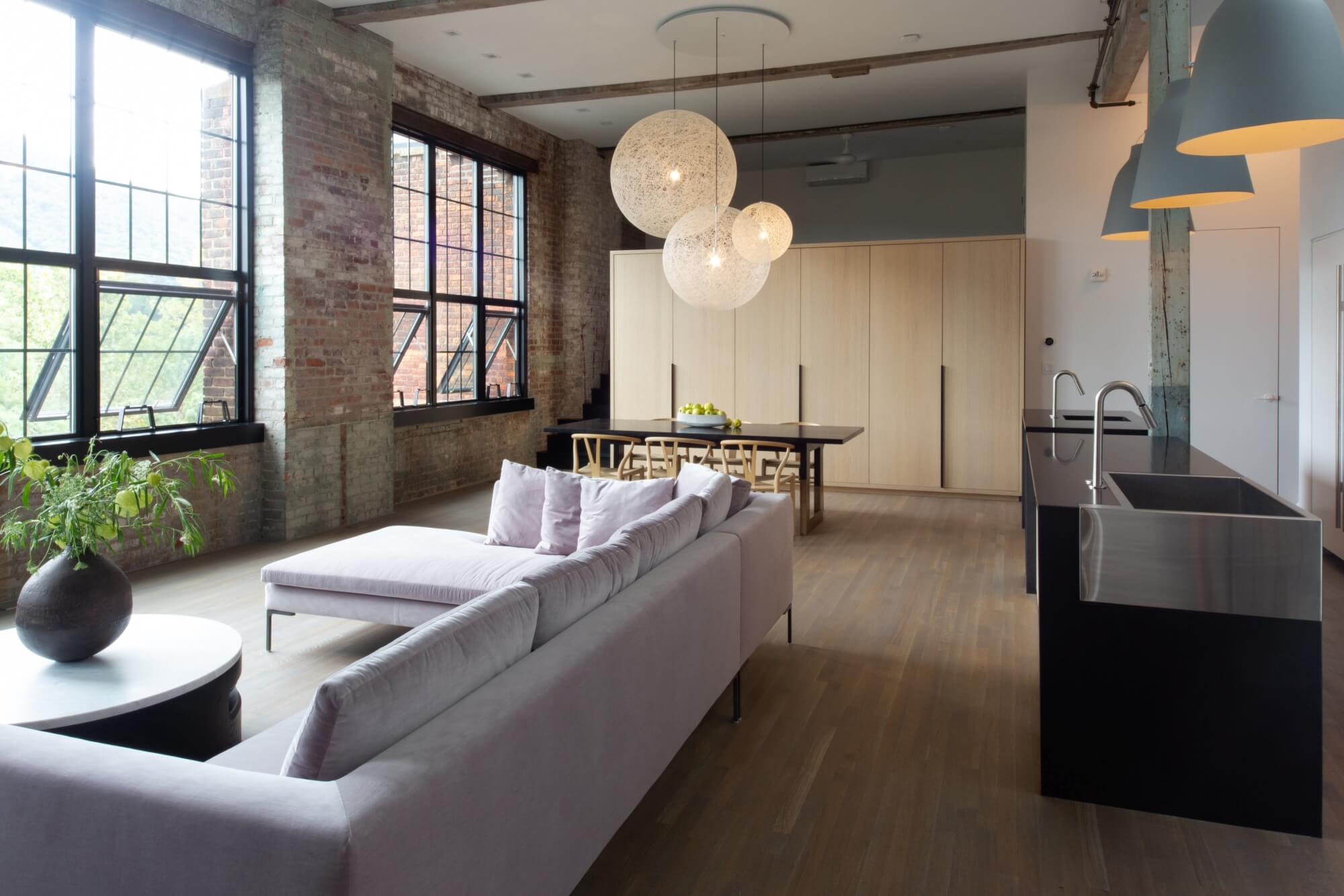 New York loft with hardwood flooring and brick walls.