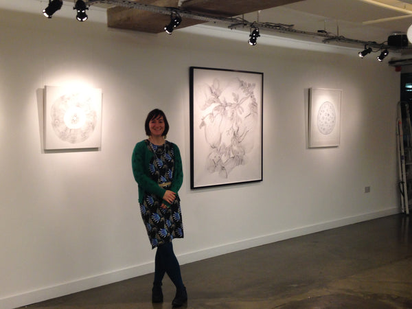 Natalie Ryde with her drawings