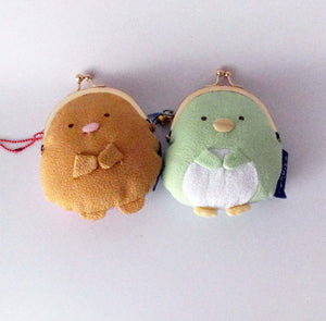 a pair of Penguin coin purse