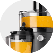 Nutribullet Juicer device and pitcher both filled with fruit juice