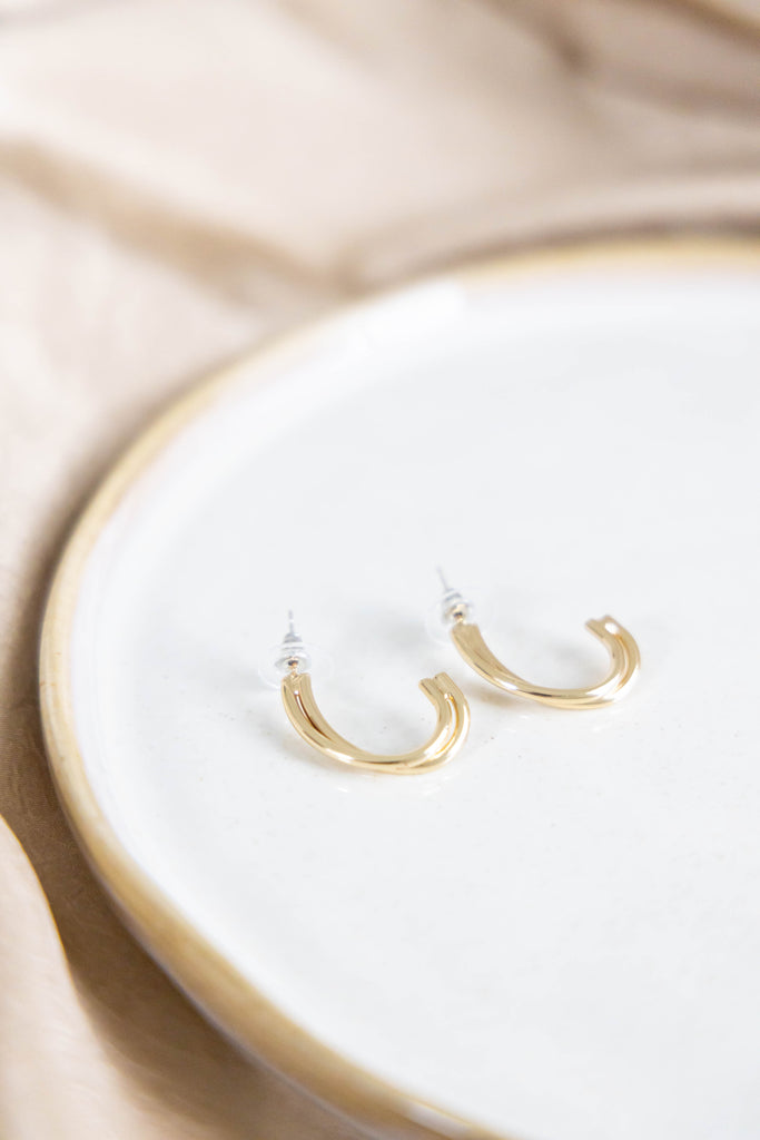Gold earrings on white background